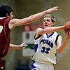 """Peak to Peak's Andrew Otey (32) looks for an open teammate as Faith Christian's Miles Finch (22) defends during the game at Peak to Peak Charter School on Wednesday, Feb. 13, 2013. Faith Christian beat Peak to Peak 62-48. For more photos visit  <a href=""""http://www.BoCoPreps.com"""">http://www.BoCoPreps.com</a>.<br /> (Greg Lindstrom/Times-Call)"""