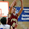 """Faith Christian's David Hawkins (11) shoots over Peak to Peak's David Griffith (21) during the game at Peak to Peak Charter School on Wednesday, Feb. 13, 2013. Faith Christian beat Peak to Peak 62-48. For more photos visit  <a href=""""http://www.BoCoPreps.com"""">http://www.BoCoPreps.com</a>.<br /> (Greg Lindstrom/Times-Call)"""