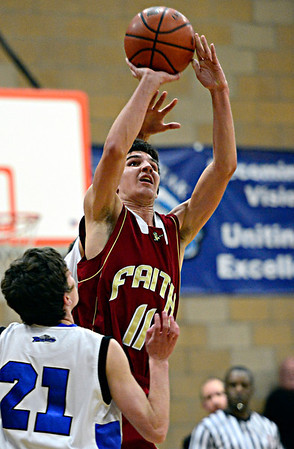 "Faith Christian's David Hawkins (11) shoots over Peak to Peak's David Griffith (21) during the game at Peak to Peak Charter School on Wednesday, Feb. 13, 2013. Faith Christian beat Peak to Peak 62-48. For more photos visit  <a href=""http://www.BoCoPreps.com"">http://www.BoCoPreps.com</a>.<br /> (Greg Lindstrom/Times-Call)"