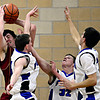 """Faith Christian's Miles Finch grabs a rebound over Peak to Peak players, left to right, Brian Goedde, Andrew Otey and Sam Fangman during the game at Peak to Peak Charter School on Wednesday, Feb. 13, 2013. Faith Christian beat Peak to Peak 62-48. For more photos visit  <a href=""""http://www.BoCoPreps.com"""">http://www.BoCoPreps.com</a>.<br /> (Greg Lindstrom/Times-Call)"""