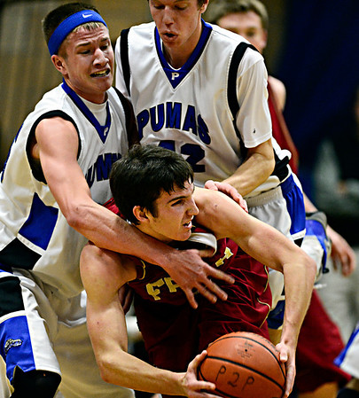 """Peak to Peak's Connor Powers, left, and Phillip Ward (42) trap Faith Christian's David Hawkins during the game at Peak to Peak Charter School on Wednesday, Feb. 13, 2013. Faith Christian beat Peak to Peak 62-48. For more photos visit  <a href=""""http://www.BoCoPreps.com"""">http://www.BoCoPreps.com</a>.<br /> (Greg Lindstrom/Times-Call)"""