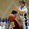"""Faith Christian's Miles Finch (22) draws a charge against Peak to Peak's Max Clark (33) during the game at Peak to Peak Charter School on Wednesday, Feb. 13, 2013. Faith Christian beat Peak to Peak 62-48. For more photos visit  <a href=""""http://www.BoCoPreps.com"""">http://www.BoCoPreps.com</a>.<br /> (Greg Lindstrom/Times-Call)"""