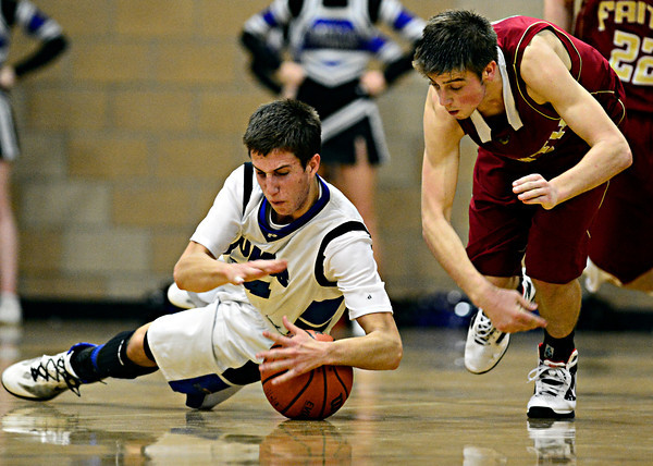 "Peak to Peak's Sam Fangman, left, dives on a loose ball during the game at Peak to Peak Charter School on Wednesday, Feb. 13, 2013. Faith Christian beat Peak to Peak 62-48. For more photos visit  <a href=""http://www.BoCoPreps.com"">http://www.BoCoPreps.com</a>.<br /> (Greg Lindstrom/Times-Call)"