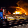 Longmont Fire Department pours water onto the burning railroad ties near the Longmont Wastewater Treatment Plant Wednesday night, April 16, 2014. (Photo courtesy Chris Rodgers)