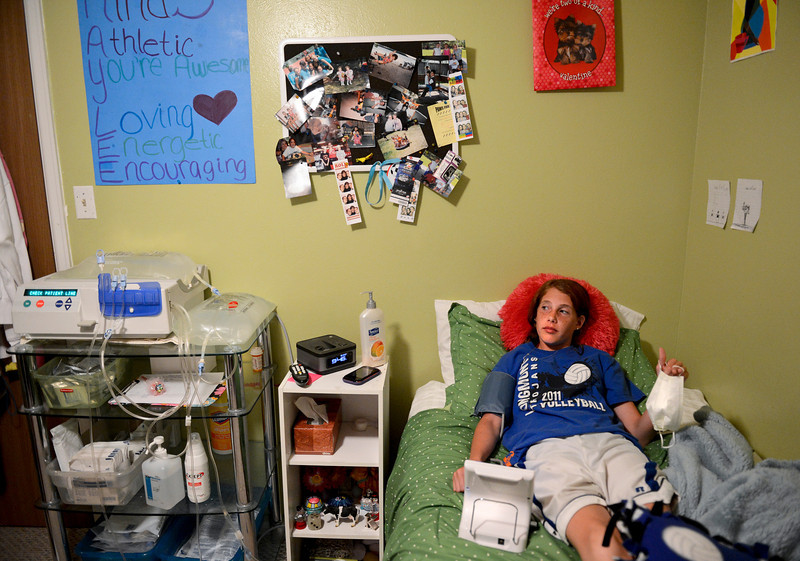 Kaylee Adams checks her blood pressure before starting her nightly dialysis in her Longmont home on Wednesday, April 25, 2012. <br /> (Greg Lindstrom/Times-Call)
