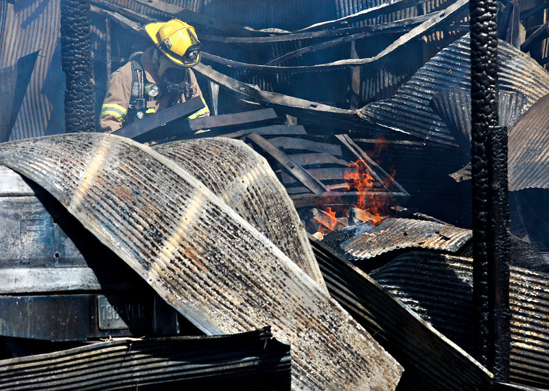Firefighters respond to a structure fire at 10157 Ute Highway on Wednesday, February 29, 2012.<br /> (Greg Lindstrom/Times-Call)