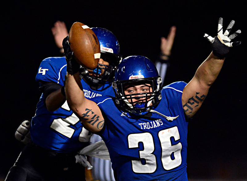 "Longmont's Joe Lopez (36) and Jamal Mangelsen (20) celebrate after Lopez blocked a Greeley Central punt and recovered the ball in the endzone for a touchdown during the game at Longmont High School on Friday, Nov. 2, 2012. Longmont beat Greeley Central 42-25. For more photos visit  <a href=""http://www.BoCoPreps.com"">http://www.BoCoPreps.com</a>.<br /> (Greg Lindstrom/Times-Call)"