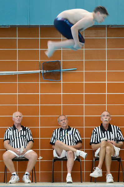 Officials, left to right, Leighton Millar, Bob Black and Ken McCrady watch as Longmont's Nick Vaughan completes a dive during the meet against Longmont at Silver Creek on Thursday, May 3, 2012.<br /> (Greg Lindstrom/Times-Call)
