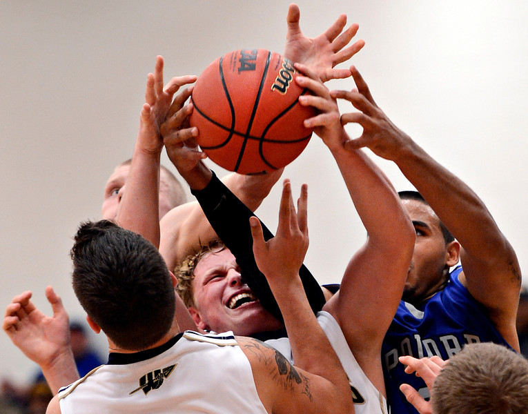 "Frederick's Ryan Miller, center, pulls down a rebound late in the fourth quarter during the game at Frederick High School on Wednesday, Nov. 28, 2012.  Frederick beat Poudre 53-51.  For more photos visit  <a href=""http://www.BoCoPreps.com"">http://www.BoCoPreps.com</a>.<br /> (Greg Lindstrom/Times-Call)"
