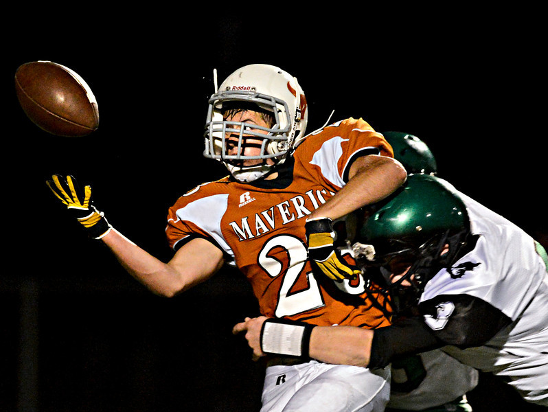 "Mead's Logan Anderson (23) can't bring in a catch in the first half as he is hit by St. Mary's Logan Elliott (3).  Mead faces St. Mary's during the varsity football game at Mead High School on Friday, Sept. 7, 2012.  For more photos visit  <a href=""http://www.TimesCall.com"">http://www.TimesCall.com</a>.<br /> (Greg Lindstrom/Times-Call)"