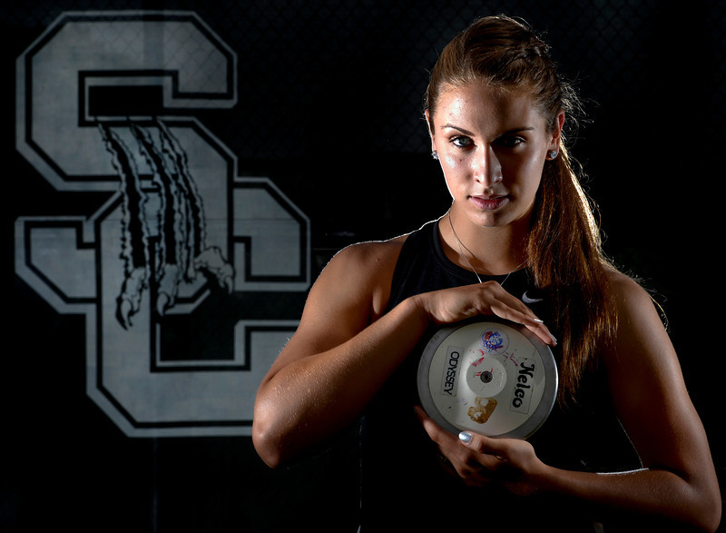 Silver Creek's Valarie Allman poses with the discus she used to break the 18-year-old Colorado state discus record at the State Track and Field Championships earlier this year.  Allman is pictured at Silver Creek High School on Tuesday, June 5, 2012.<br /> (Greg Lindstrom/Times-Call)