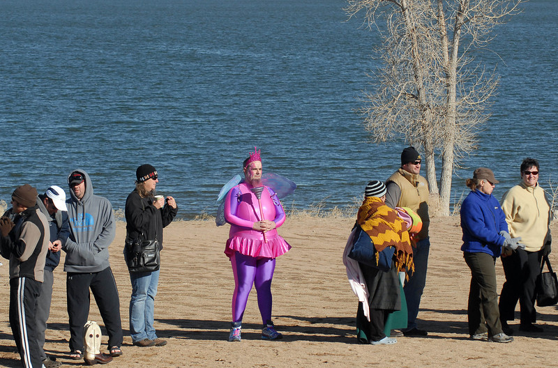"""Booboo"" Wilde, 41, of Lakewood, waits in line before the start of the annual Young Professionals Alzheimerís Association of Colorado Polar Plunge 2012 at the Boulder Reservoir Sunday Jan. 01, 2012. ""It's a cheap adrenaline rush for people in my shape,"" Wilde said. (Lewis Geyer/Times-Call)"