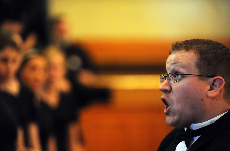 Director Jeremy Skelton conducts Silver Creek's Bella Voce 32-member choir as they perform in the senate chambers during the opening day of the 2012 session of the Colorado Legislature Wednesday Jan. 11, 2012. (Lewis Geyer/Times-Call)