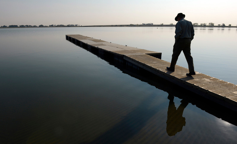 Reservoir superintendent Dennis Yanchunas walks onto a dock at Union Reservoir Thursday morning Sept. 20, 2012. (Lewis Geyer/Times-Call)