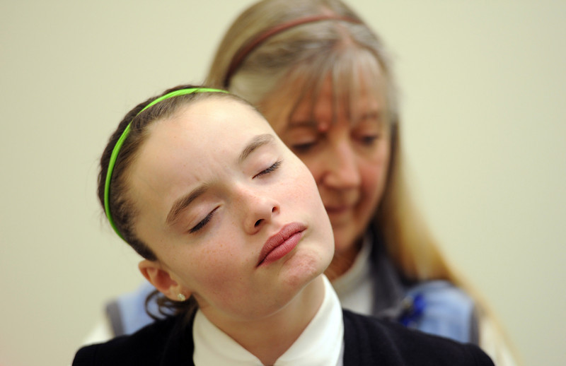Riley Ljungdahl, a fifth grader at St. John the Baptist Catholic School, who last year became paralyzed below her chest, works with occupational therapist Mary Odrzywolski at Longmont United Hospital Thursday Feb. 02, 2012. (Lewis Geyer/Times-Call)