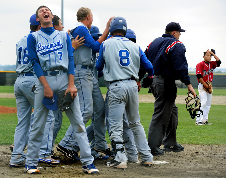 Longmont celebrates at the plate after Fort Morgan pitcher David Mendez, right, balked in the eighth inning allowing Longmont to score the game-winning run Saturday May 12, 2012 during their 4A district tournament game in Greeley.  (Lewis Geyer/Times-Call)