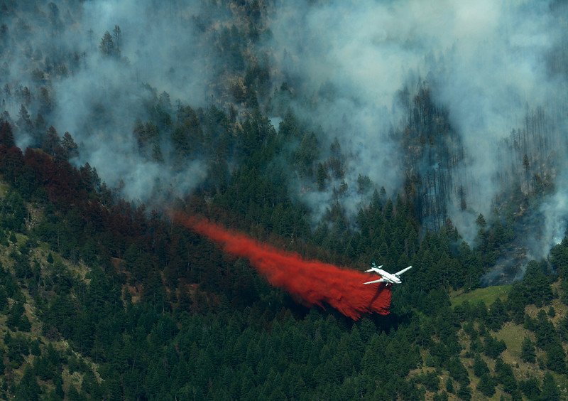 A slurry bomber tries to create a barrier to keep the fire from spreading, Tuesday, June 26, 2012 near Boulder.<br /> (Matthew Jonas/Times-Call)
