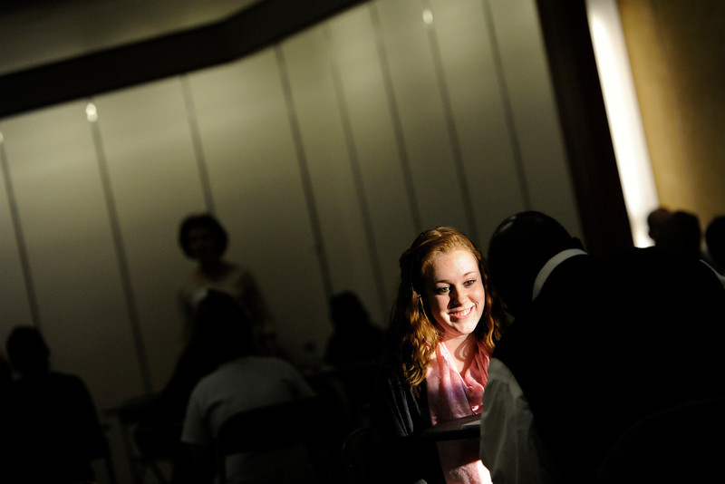 From left: The sun shines through a doorway illuminating Niwot High School sophomore Caroline Mahony as she talks with Joel Odonkor, of Intrado, in a mock interview during a St. Vrain Valley School District/Workforce Job Fair Thursday, March 8, 2012 in the former location of J.C. Penny at Twin Peaks Mall.<br /> (Matthew Jonas/Times-Call)