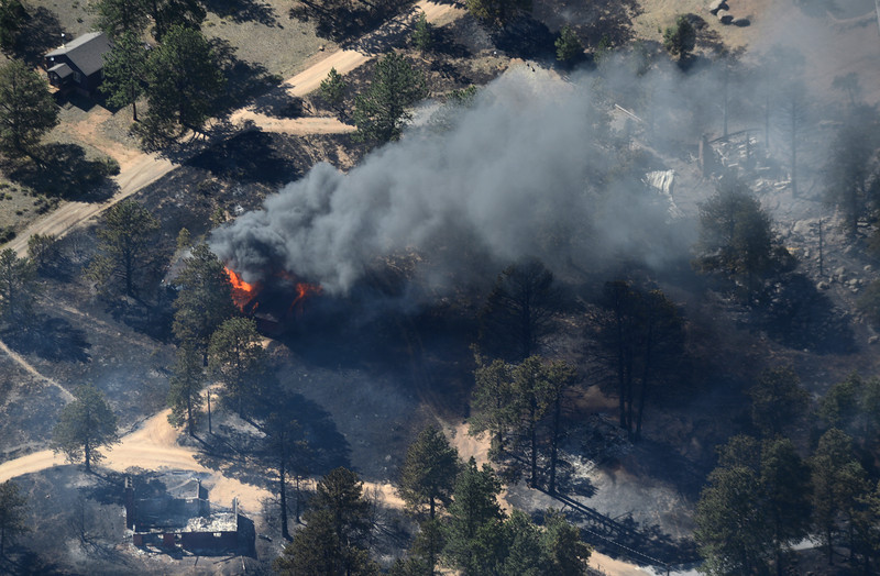 A structure burns near Estes Park Saturday, June 23, 2012, near the entrance to Rocky Mountain National Park. 21 homes and cabins were destroyed by the fast moving fire.<br /> (Matthew Jonas/Times-Call)