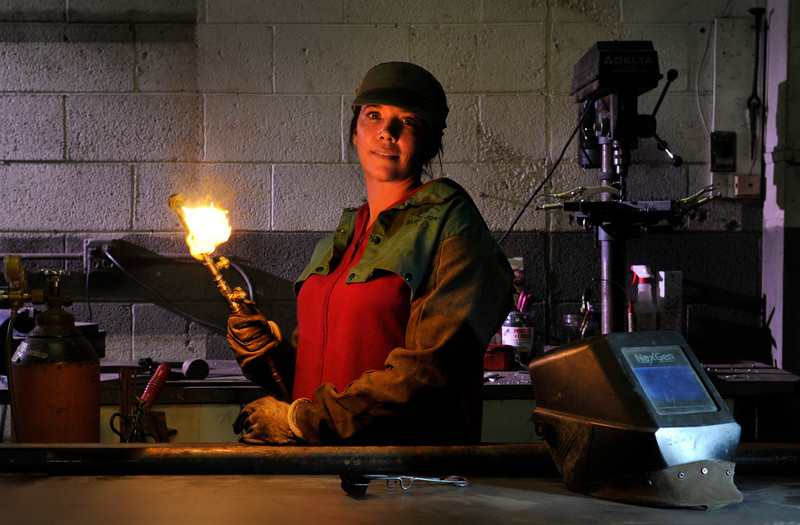Joan of Arc Welding owner Ashley Honeyman poses for a portrait, Tuesday, Dec. 4, 2012, at her workshop in Longmont.<br /> (Matthew Jonas/Times-Call)