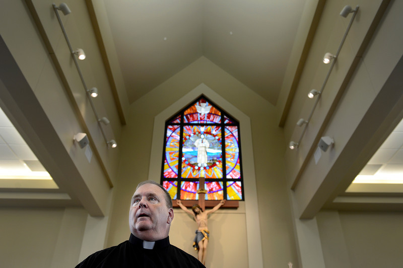 Father Frank Maroney takes a look at the progress inside the nave, the part of the church where the congregation will sit, Wednesday, Oct. 3, 2012, at the new St. Francis of Assisi Catholic Church in Longmont.<br /> (Matthew Jonas/Times-Call)