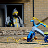 20130218_DEATH_INVEST_089.jpg Children's toys are seen in the front yard as Longmont Police investigate the death of a 6 year old child in an apartment, Monday, Feb. 18, at 706 Darby Court.<br /> (Matthew Jonas/Times-Call)