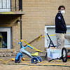 Longmont Police Department evidence technician Dawn Cavins, right, waits outside as Longmont Police investigate the death of a 6 year old child at an apartment, Monday, Feb. 18, at 706 Darby Court.<br /> (Matthew Jonas/Times-Call)
