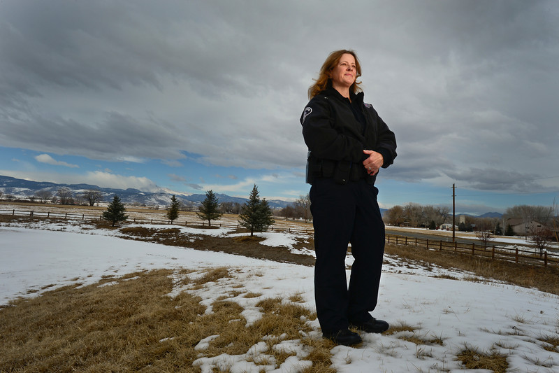 Boulder County Sheriffs Deputy Sue Cullen poses for a portrait, Friday, March 1, 2013, in Longmont. Cullen was recently recognized by the department for her work with a needy family in the community.<br /> (Matthew Jonas/Times-Call)