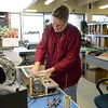 Jennifer Key assembles a 9500 chassis at Q.S.C. Systems, an RF Concepts partner, where Alpha Amplifiers are built, Wednesday, Jan. 16, 2013. (Lewis Geyer/Times-Call)