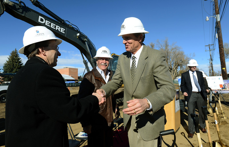 "Developer Cotton Burden, center, shakes hands with Lindsey Vanderheiden, of Wells Fargo, after the groundbreaking ceremony for the Roosevelt Park Apartments Tuesday morning Nov. 13, 2012. TO VIEW A VIDEO AND SLIDESHOW VISIT  <a href=""http://WWW.TIMESCALL.COM"">http://WWW.TIMESCALL.COM</a> (Lewis Geyer/Times-Call)"