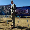 "Developer Cotton Burden stands between renderings of the Roosevelt Park Apartments before the groundbreaking ceremony for the development Tuesday morning Nov. 13, 2012. TO VIEW A VIDEO AND SLIDESHOW VISIT  <a href=""http://WWW.TIMESCALL.COM"">http://WWW.TIMESCALL.COM</a> (Lewis Geyer/Times-Call)"