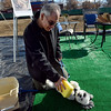 "West Roybal demonstrates a dog wash on his dog Ty at the groundbreaking for the Roosevelt Park Apartments Tuesday morning Nov. 13, 2012. The development will feature a bike and dog washing station. TO VIEW A VIDEO AND SLIDESHOW VISIT  <a href=""http://WWW.TIMESCALL.COM"">http://WWW.TIMESCALL.COM</a> (Lewis Geyer/Times-Call)"