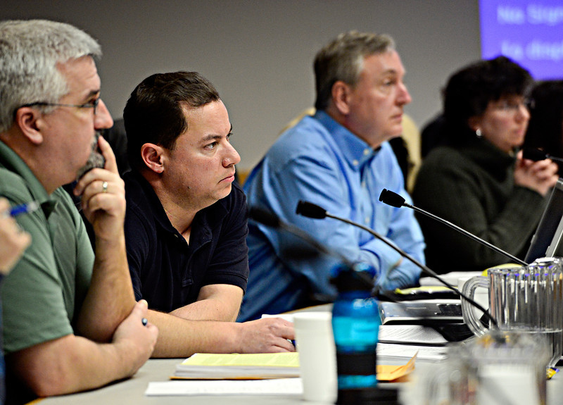 Town of Firestone planning commission members, left to right, Steve Schernecke, vice-chairperson; Jeremy Pilon, chairperson; Kevin Bixler, commissioner; Kelly Deitman, commissioner; listen as members of the public discuss the Second Amendment Firearms Experience gun training center -- planned for 900 acres near Colo. Highway 66 and Weld County Road 17 -- during the Firestone planning commission meeting in Firestone on Tuesday, Feb. 12, 2013. <br /> (Greg Lindstrom/Times-Call)