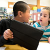 Fifth-grader Jamie Luna, right, reacts as she and Sam Chen explore the Grand Canyon using Google Earth on an iPad at Ryan Elementary School in Lafayette on Wednesday, Jan. 16, 2013. <br /> (Greg Lindstrom/Times-Call)