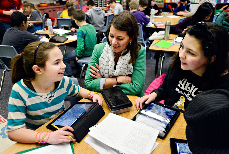 Stephanie Schroeder, center, program manager of STREAM, helps fifth-graders Jamie Luna, left, and Vienna Manzanares with an exercise involving iPads and Google Earth at Ryan Elementary School in Lafayette on Wednesday, Jan. 16, 2013. <br /> (Greg Lindstrom/Times-Call)