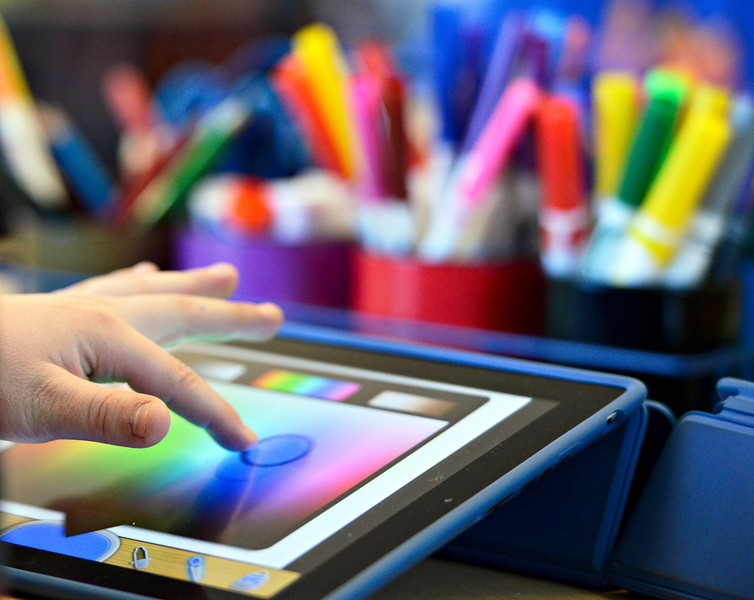 Third-grader Gavin Caraway selects a color while drawing on an iPad at Ryan Elementary School in Lafayette on Wednesday, Jan. 16, 2013. <br /> (Greg Lindstrom/Times-Call)