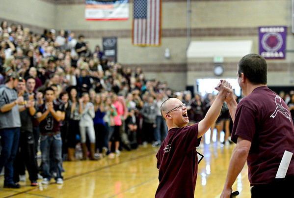 Wesley Summers is congratulated by athletic director  after receiving the High School Hero of the Week award during the fall sports assembly at Silver Creek High School on Friday, Jan. 4, 2013.  <br /> (Greg Lindstrom/Times-Call)