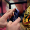 """Silver Creek's John Harper takes a picture of the state championship trophy after the fall sports assembly at Silver Creek High School on Friday, Jan. 4, 2013. For more photos visit  <a href=""""http://www.BoCoPreps.com"""">http://www.BoCoPreps.com</a>.  <br /> (Greg Lindstrom/Times-Call)"""