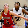 Centaurus High School's Taylor Langer (No. 4) tries to box out Silver Creek High School's Grace Reed (No. 50), Friday, Feb. 1, 2013, at SCHS. The Warriors defeated the Raptors, 51-47.<br /> (Matthew Jonas/Times-Call)