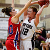 Centaurus High School's Gianna Manfredini (No. 10) pressures Silver Creek High School's Julie Dauer (No. 12), Friday, Feb. 1, 2013, at SCHS. The Warriors defeated the Raptors, 51-47.<br /> (Matthew Jonas/Times-Call)