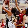 Silver Creek High School's Margaret Davis (No. 3) collides with Centaurus High School's Midori Patterson (No. 15), Friday, Feb. 1, 2013, at SCHS. The Warriors defeated the Raptors, 51-47.<br /> (Matthew Jonas/Times-Call)