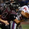 Silver Creek High School's Dakota Silva (No. 34) brings down Centaurus High School's Matthew Buchler (No. 29) during the fourth quarter, Friday, Sept. 7, 2012, at Everly-Montgomery Field in Longmont. The Raptors defeated the Warriors, 46-12.<br /> (Matthew Jonas/Times-Call)