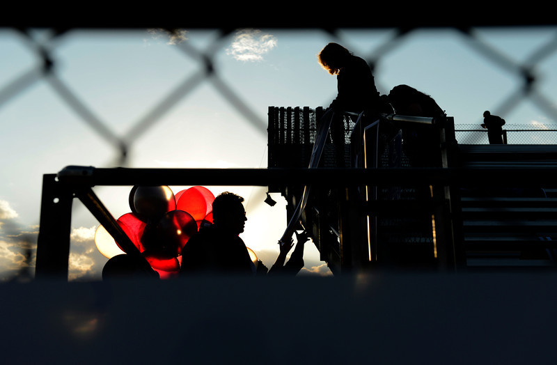 Silver Creek High School fans hang balloons and banners on the bleachers before the start of the game against Centaurus High School, Friday, Sept. 7, 2012, at Everly-Montgomery Field in Longmont.<br /> (Matthew Jonas/Times-Call)