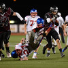 Silver Creek High School's Trey Fleming (No. 21) runs through Centaurus High School's Tyler Harrington (No. 27) during the second quarter, Friday, Sept. 7, 2012, at Everly-Montgomery Field in Longmont.<br /> (Matthew Jonas/Times-Call)