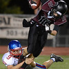 Centaurus High School's David Shald (No. 9) takes down Silver Creek High School's Zane Lindsey (No. 11) during the third quarter, Friday, Sept. 7, 2012, at Everly-Montgomery Field in Longmont. The Raptors defeated the Warriors, 46-12.<br /> (Matthew Jonas/Times-Call)