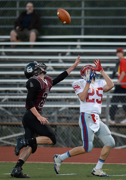 Silver Creek High School's Ross Fitzgerald (No. 29) tries to block the pass to Centaurus High School's Brody Jaskul (No. 25) during the first quarter, Friday, Sept. 7, 2012, at Everly-Montgomery Field in Longmont.<br /> (Matthew Jonas/Times-Call)