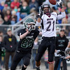 Silver Creek High School's Trey Fleming (No. 21) has trouble holding onto the ball while covered by Conifer High School's Erick Probeck (No. 82) during the second quarter, Saturday, Nov. 24, 2012, at Trailblazer Stadium in Lakewood.<br /> (Matthew Jonas/Times-Call)