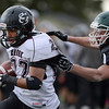 Silver Creek High School's Josh Quiroz (No. 22) scores a touchdown while evading the grasp of Conifer High School's Brandon Payer (No. 8) during the fourth quarter, Saturday, Nov. 24, 2012, at Trailblazer Stadium in Lakewood.<br /> (Matthew Jonas/Times-Call)