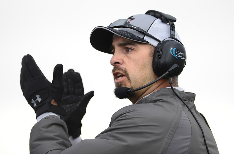 Silver Creek High School's head coach Mike Apodaca claps after a good play in the game against Conifer High School during the second quarter, Saturday, Nov. 24, 2012, at Trailblazer Stadium in Lakewood.<br /> (Matthew Jonas/Times-Call)