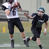 Silver Creek High School's Brock Ricks (No. 6) completes the pass out of the reach of Conifer High School's Hunter Shively (No. 16) during the fourth quarter, Saturday, Nov. 24, 2012, at Trailblazer Stadium in Lakewood.<br /> (Matthew Jonas/Times-Call)